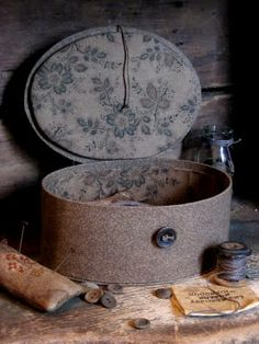 love this fabric sewing box.  I'm sure you could make something like this. Material, button and paper mache box and glue on material. I'm going to try this!