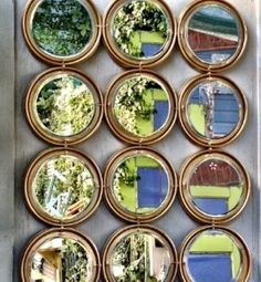 Turn paint can lids into a pretty outdoor mirror. | 31 Cheap And Brilliant Dollar Store Hacks