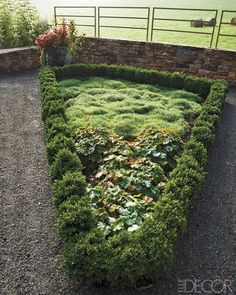 Crushed-stone paths divide the monastery garden, which is planted with dianthus. http://weathertightroofinginc.com #roofer #roofing #rooferhemet #roofrepair #localroofer