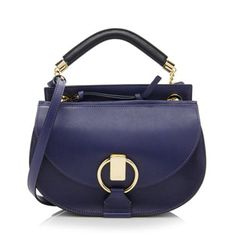This Chloe shoulder bag is made from Storm Blue calfskin and suede with a black leather handle and gold-tone hardware. Details include a detachable shoulder strap, front flap pocket, and zip closure. The interior is fully lined with one zippered pocket. Carry this style hand-held, over the shoulder, or cross body.