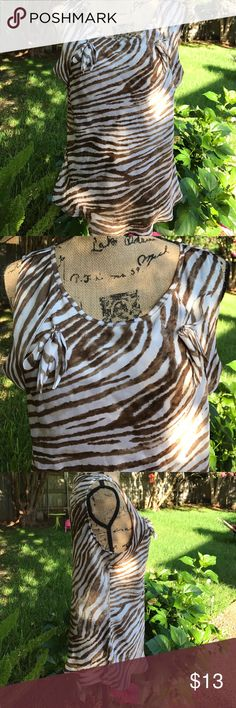 Pretty brown and white sleeveless top This top is 100% polyester and feels so silky. Very comfortable and flattering worn with brown, white, or cream colored shorts!! Excellent condition. new directions Tops Blouses