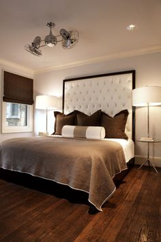 very unique ceiling fan...love the color scheme, bedside lamps and high headboard