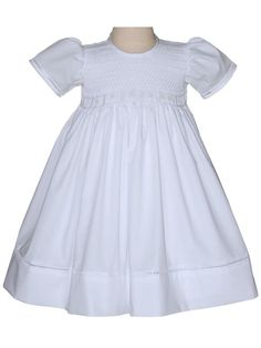 This is Faith, a beautiful all white christening communion cotton dress with detailed smocking across the bodice and delicate hand stitched half daisies within the smocking and beads. The back of the dress has buttons and a long sash to finish in a bow. Girls Communion Dresses, Girls Smocked Dresses, Cotton Dresses, Flower Girl Dresses, White Silk Dress, Girls White Dress, White Girls, Christening Gowns, Overall Dress