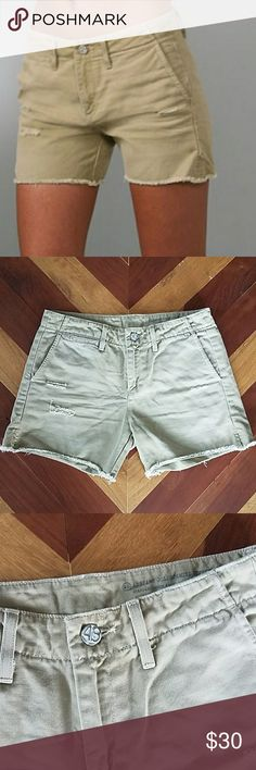 """AG Adriano Goldschmied Khaki Shorts Standard issue khaki shorts, boy fit. A few manufactured distressed spots on front, cut off style. Front and back pockets. Some wear, but still in great shape.   Inseam =4.25"""" Waist =14.5"""" Ag Adriano Goldschmied Shorts"""
