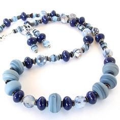 Upgrade your casual look with this artsy denim blue necklace set. Its unique blend of art glass and ceramic beads will set you apart. $62 SOLD