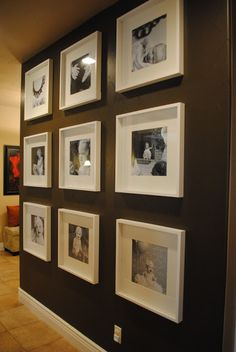 Gorgeous dark wall with contrasting white framed and B photos. Notice the stenciled trellis on wall, too.
