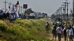 Farmworkers march Thursday along the Baja Peninsular Highway near San Quintin, Mexico, in a peaceful but angry show of force after growers refused to meet their demands to boost wages. (Don Bartletti / Los Angeles Times)