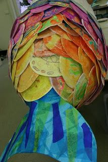 huge fish sculpture with paper plate scales