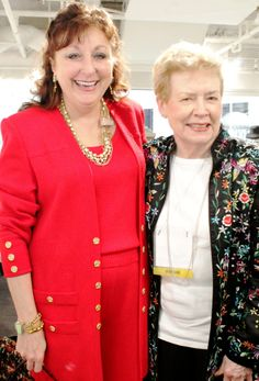 Patti Quinn, Aurora Glass artist, stunning in red St. John couture, thrilled to be featured with retail legend Ann of Ann's Fine Gifts!
