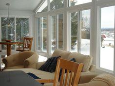 Cozy Sunroom... Love these windows