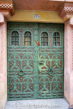 Copper and bronze door detail from 18th century house in Freiburg, Germany.