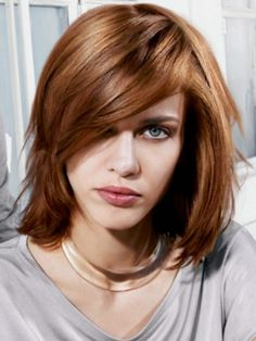 Seriously considering cutting my hair like this ....  long bob, side swept bangs, reddish hair color