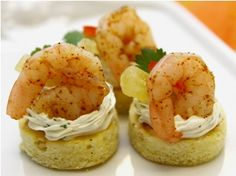 Not only do these shrimp appetizers look great, they taste fantastic. Cold shrimp appetizers are a hit at any party and these tasty party appetizers really hit the spot.    Island seasoned Shrimp on coconut cornbread with cilantro mousse and candied pineapples