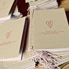 Red-and-white baker's twine bound together the simple kraft paper programs.