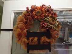 Fall wreath for my front door. I repurposed an old green Christmas wreath. I cut lots of pieces of wire, then using a roll of the ribbon I wired in fluffy loops trying to cover all of the green. I went to hobby lobby and bought the picks and the H. I painted the H black with my acrylic black paint, then hot glued it on. Lastly, I  positioned the picks where I wanted them, then hot glued them.