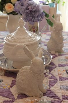 Aiken House & Gardens: Spring Time Vignettes.     A pair of bunnies on transferware and a vintage quilt