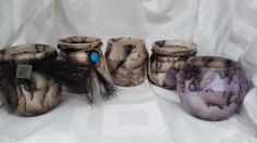 Dancing Fire Pottery Just Shipped These Handcrafted Creations to Happy Owners— Vases, Horsehair Wrapped Vases, Earrings, Necklaces, Ornaments Our pottery starts with white clay that is hand thrown on the wheel. While hot, individual strands of hair are laid against the surface.
