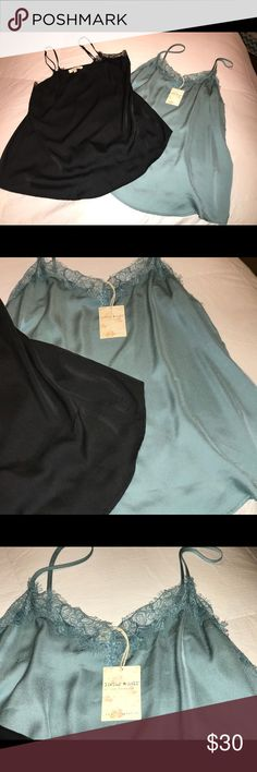 LIVING DOLL CAMI'S SIZE L NWT ABSOLUTELY GORGEOUS! LIVING DOLL CAMI'S SIZE L NWT ABSOLUTELY GORGEOUS! Two Loving Doll Cami's. The teal one still has tag, but neither has been worn. Both brand new. LIVING DOLL Tops Camisoles
