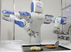"Japanese giant Yaskawa Electric's industrial robot Motoman turns over an ""okonomiyaki"", a Japanese pancake at a robot exhibition in Osaka. A team of American and Australian researchers claim they have created algorithms that enable robots to learn operational skills by watching human activities. They ""taught"" their robot to cook by showing it some YouTube videos. Researchers from the University of Maryland and the Australian research center NICTA have been ""educating"" their robot using the…"