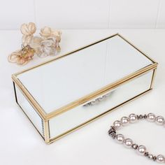 A very chic and pretty way to keep jewellery safe! This mirrored jewellery box features a copper edging and a generous amount of room inside perfect for holding bracelets, rings, earrings, brooches and necklaces. This is a wonderful gift idea for a birthday, wedding anniversary.