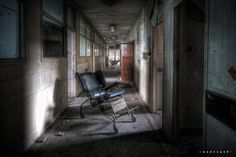 "https://flic.kr/p/9qqF7J | the chairs | Chairs in a corridor in a UK hospital abandoned in 1992.  More documentary shots on <a href=""http://uexplorer.wordpress.com/2011/06/29/hospital-m/"" rel=""nofollow"">my blog!</a>  From the ""1000 miles and running"" tour. 10 urbex locations all around UK in 4 days.   On tour with <a href=""http://www.flickr.com/photos/andregovia/"">Andre Govia</a>, <a href=""http://www.flickr.com/photos/rustycosworth/"">Rusty Photography</a>,  <a ..."