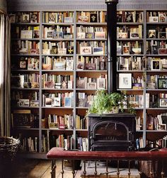 On the hunt for fireplace inspiration? Check out these stunning built-in bookshelves, this classic wood-burning stove, and more home library decor ideas for book lovers. Cozy Library, Library Room, Dream Library, Library Ladder, Future Library, Future Office, Library Fireplace, Fireplace Shelves, Wall Bookshelves