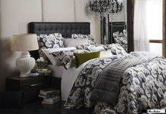 Another beauty from Legend - Florence Broadhurst's Japanese Floral bedlinen in graphite. This stunning arrangement also features Kabuki quilted in linen cushion, Chinese Key matelasse white pillows and cushions, olive velvetine long cushion and a silver velvetine throw.