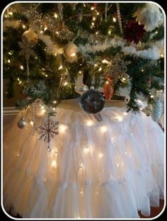 Tulle tree skirt w/lights--wouldn't want tiered ruffles tho'--just a long foofy tutu!