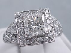 This is our spectacular 3.13 ctw Princess Cut Diamond Engagement Ring. It has an immaculate 1.82 carat Princess Cut F Color/VS2 Clarity (Clarity Enhanced) Center Diamond. Set in a beautifully crafted 18K White Gold setting with endless diamond accents of assorted sizes, this ring is on fire! Listed for $9,990. Modern Jewelry, Fine Jewelry, Halo Rings, Princess Cut Diamonds, Beautiful Earrings, Diamond Engagement Rings, Jewelry Collection, White Gold, Bling