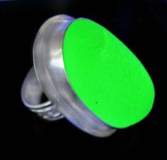 """By far, our largest, rarestand brightest UV lime """"Vaseline Glass"""" piece is set into this bold and beautiful statement ring.  The vibrant, 1.25"""" long behemoth originates from Depression Era Vaseline Glass. It is colored with Uranium Dioxide to give the piece the bright green color. It GLOWS very brightly under a black light (as photographed). In natural light it is a luminous bright lime green."""