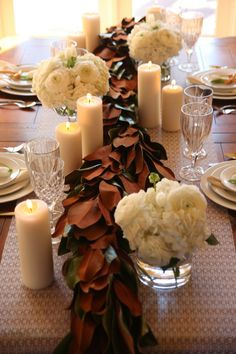 Thanksgiving table, magnolia garland with white candles and centerpieces... www.thepolishedpetal.com