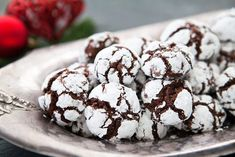 Chocolate cookie dough rolled in powdered sugar and baked into a festive black and white cookie.