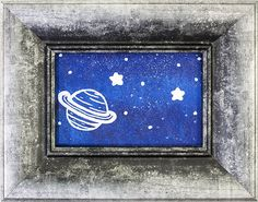 Beyond is an abstract painting by Heather Miller of WhiteRose's Art. Created with vibrants shades of blue spray paint, it is embellished with a painted white planet & stars. It comes framed in a striking silver and black wooden frame.