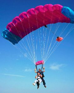 sky dive with a pretty pink parachute haha