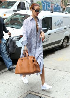 Rihanna in a shirt dress out in New York. See all of her best looks.