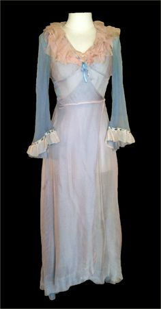 "Vivien Leigh costume from ""A Streetcar Named Desire"". The dressing gown is made of blue chiffon with a pink chiffon overlay and has ruffles on the bodice and cuffs. There is also lace trim on the bodice in between the ruffles as well as near the cuffs. There is a small silk bow in the center of the bust, and the gown closes on one side with a snap. It originally also had a silk sash that she wore with it which is no longer present. Costume designer - Lucinda Ballard"