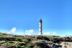 An unusual attraction on Aruba's rugged northwest tip is the California Lighthouse. Named after a ship that wrecked on a dark night, the lighthouse was built to prevent similar disasters from happening again. Vacation Places, Best Vacations, Places To Travel, Places To See, California Lighthouse, North America Destinations, Places Worth Visiting, Island Pictures, Beautiful Landscapes