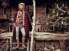 Alpaca/cotton coat, £1,670, by Etro. Wool top, €628, by Dries van Noten. Cashmere/silk long johns, £350, by John Smedley. Wool socks, £20, by Scott Nichol. Leather boots, £245, by Red Wing. Gold Cybele necklace, £975, and silver rings, £200 each, all by Wright & Teague  Bark reindeer, from £6.75, bark pine trees, £5 (in Christmas tree and on window ledges), vine stars, £4.50, vine wreath £12 (far left on floor), and vintage wooden skis and poles (just seen), £120 for both, all from Bailey...