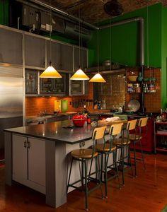 Warm kitchen with brick tile backsplash.