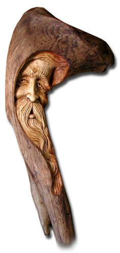 I like the hood/peaking aspect of this walking stick wood spirit face