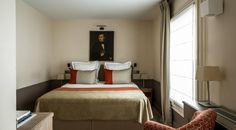Unique and peaceful hotel rooms for your stay in Paris. Have A Shower, Surface Area, Paris Hotels, Free Wifi, 4 Star Hotels, Antique Furniture, Brighton, Bed, Classic