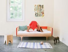 The Caravan Divan toddler bed by Kalon Studios transitions into a comfy couch. Double-duty design!