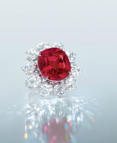 The Crimson Flame. An extrordinary 15.04 carats Burma Mogok 'Pigeon Blood Red Ruby and Diamond ring.