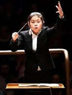 Elim Chan (1987) became the 1st female winner of the Donatella Flick LSO Conducting Competition in 2014. She was then appointed Assistant Conductor of the London Symphony for 2015/16 conducting  a number of their education concerts. She took part in a week of masterclasses with Haitink in Lucerne, Elim will return there in summer 2016 to  debut with the Lucerne Festival Academy Orchestra. Future appointments include concerts in France, Italy and China.