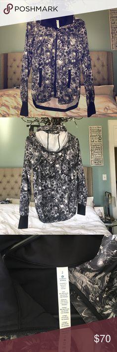 Lululemon Workout Jacket Black & White Floral Size 2. Only worn once black and white Lululemon floral print workout jacket. Lightweight with removable hood. lululemon athletica Jackets & Coats