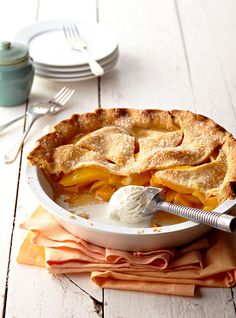 Our Peach-Mango Pie recipe is a sweet, tropical treat. Artfully combine the delicious flavors from fresh peaches and mangoes in the homemade, flaky pie crust for a truly delightful dessert. Peach Mango Pie, Fresh Mango Pie Recipe, Summer Cookout Desserts, Peach Tart Recipes, Delicious Desserts, Dessert Recipes, Yummy Recipes, Pie Pops, Peach Cake