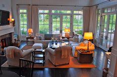 windows above the doors a must, dark wood floor