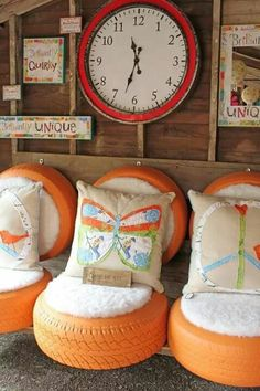 Painted old tires with added padding.... this would be great for an outdoor area or childrens playhouse!