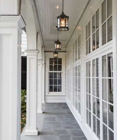 Beautiful porch / veranda. Love the grey tiles in a roman pattern.