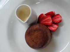 Moist bread pudding, amarula anglaise, marinated strawberries, creamy liqueur